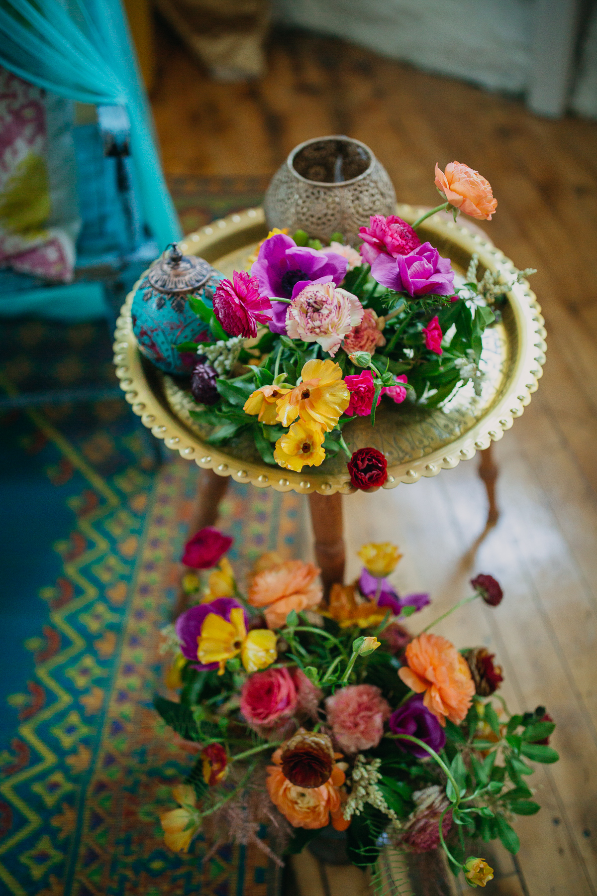 Bright flowers, brass plates and lanterns for decoration.