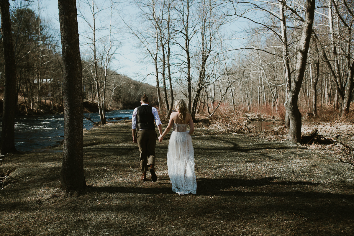 Bride and grooms down by the water for their couple session.