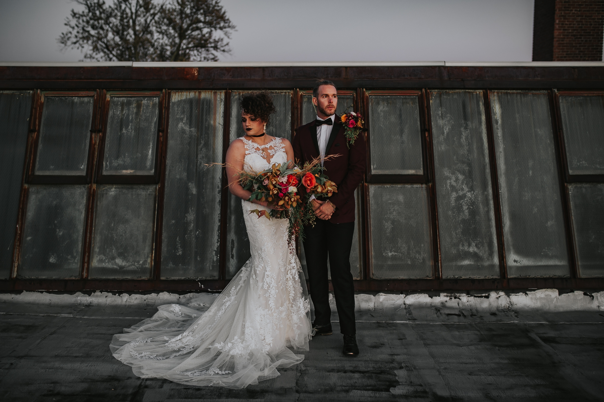 Power couple with Liliian West gown and JTGhamo maroon suit - Pearl Weddings & Events