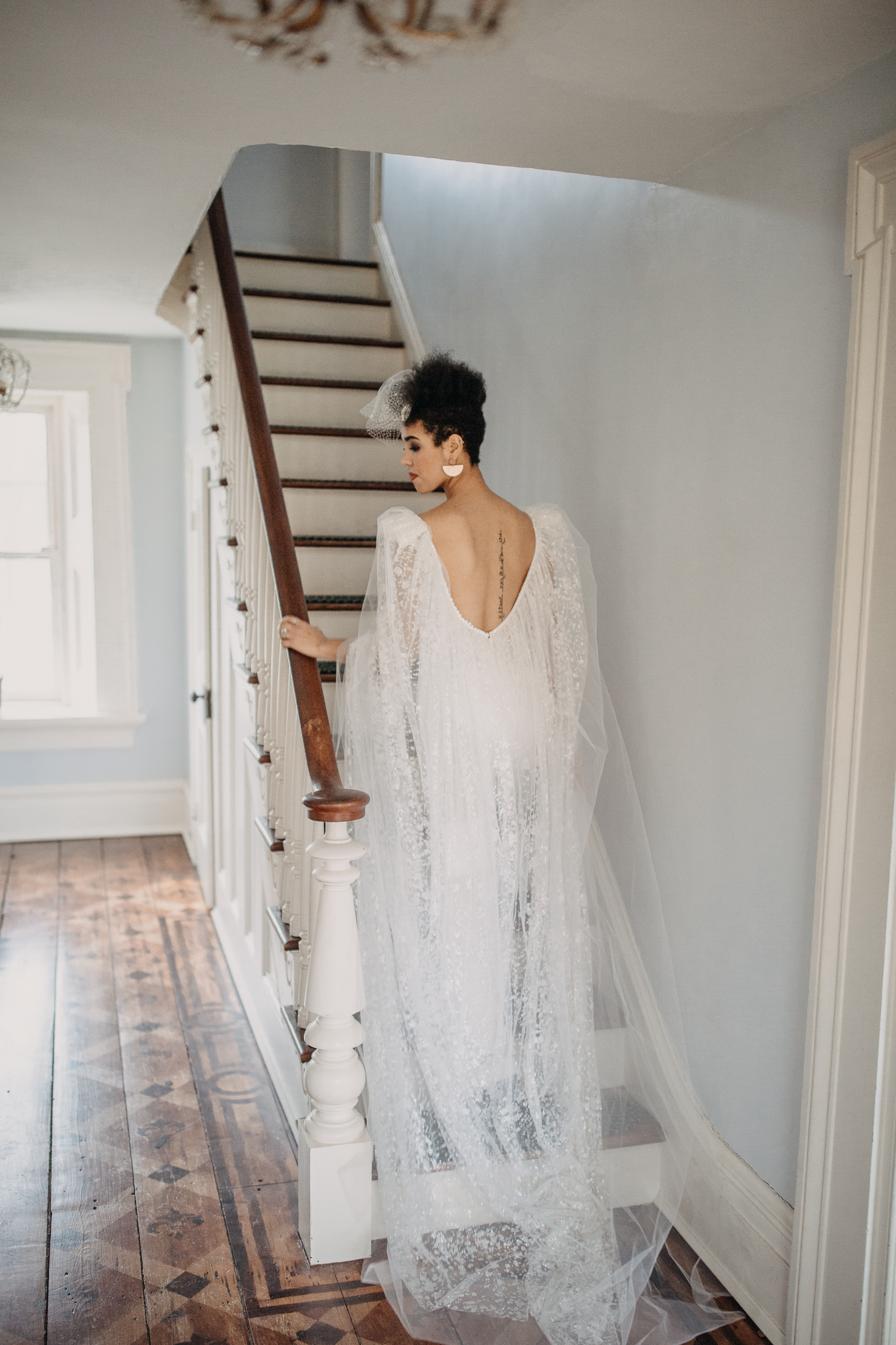Pant suit wedding gown with a cape from Dany Mizarachi Bridal - Pearl Weddings & Events