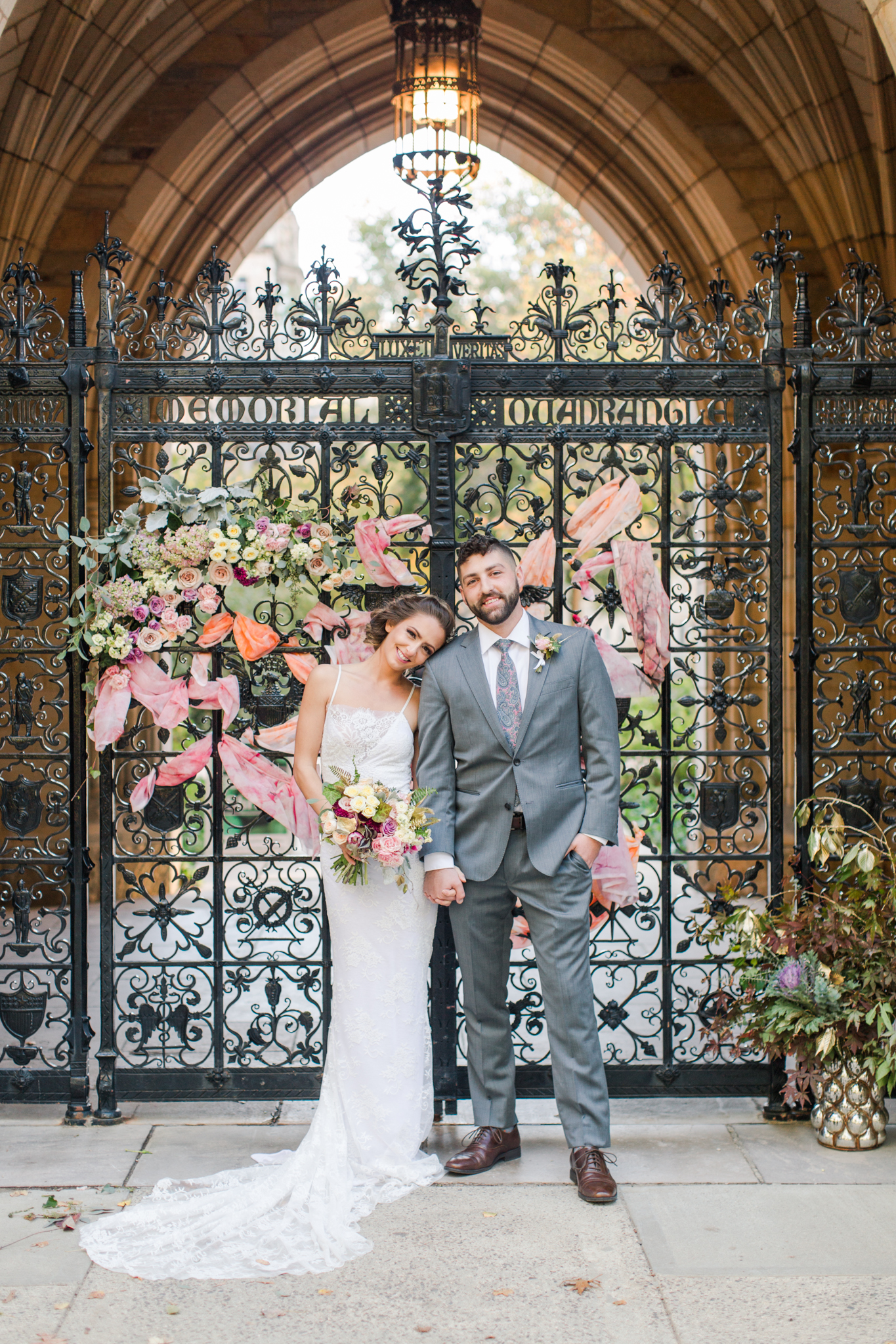 Yale University Wedding - Fence ceremony backdrop with pink, yellow and orange art and floral installation. Pearl Weddings & Events