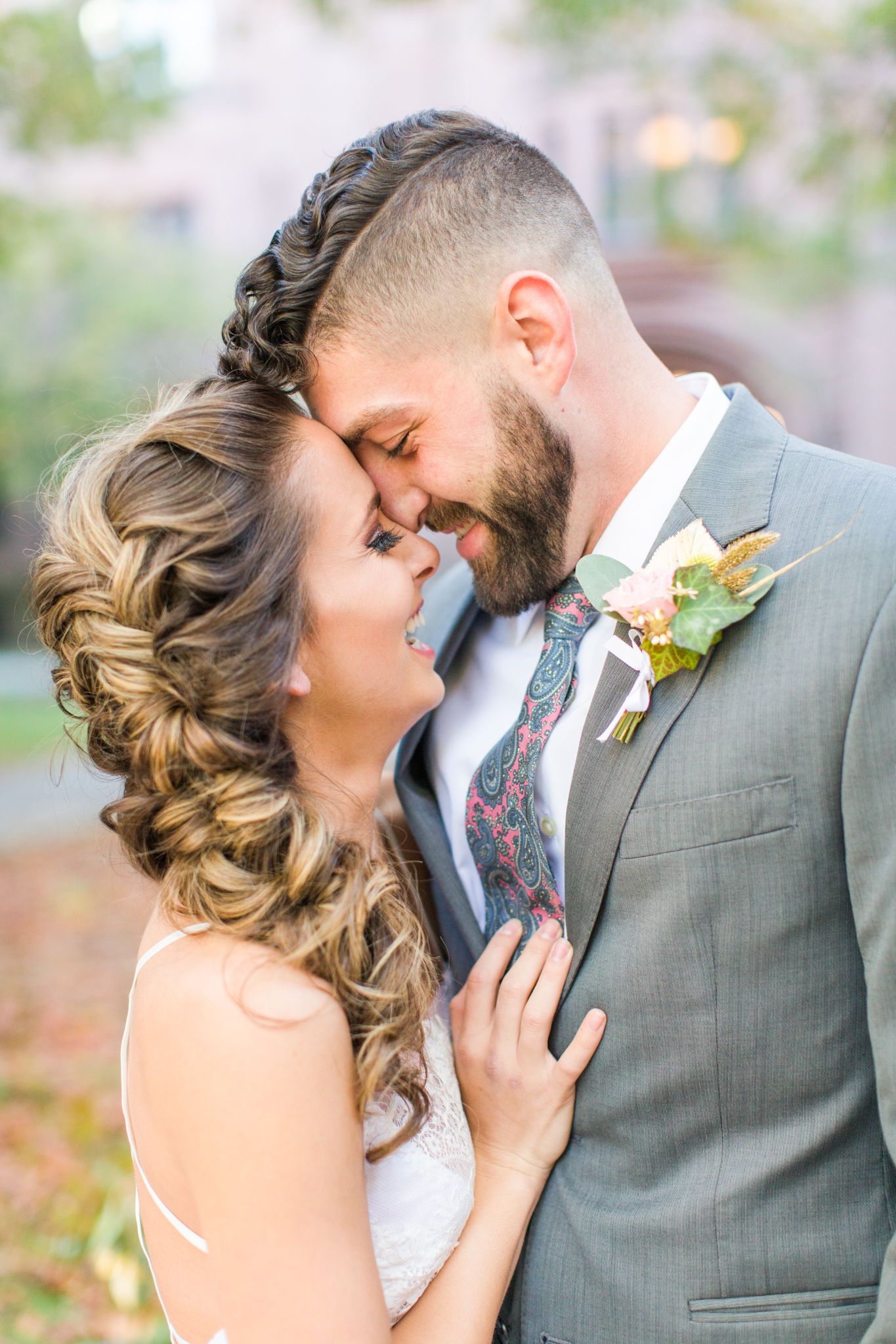 Cute bride & groom photo session! Loose braid Bridal updo. Pink paisely grooms tie! Pearl Weddings & Events