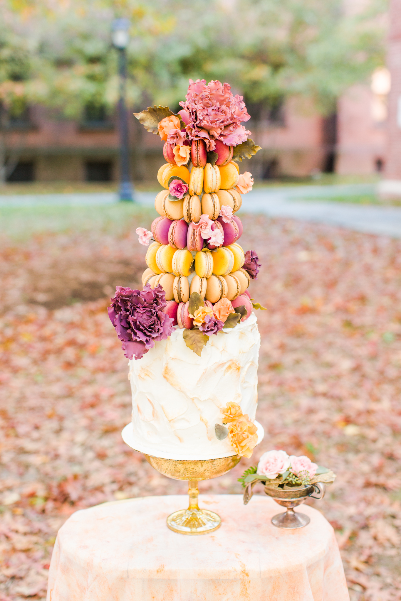 Macaroon tower cake with pink, yellow, orange color scheme! The most beautiful wedding cake ever. Pearl Weddings & Events.