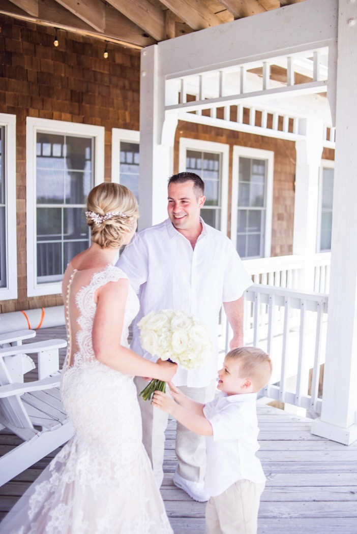 First look at the beach! Katie & Mark's destination wedding in the Outer Banks of Corolla North Carolina. Planned & Designed with Pearl Weddings & Events.