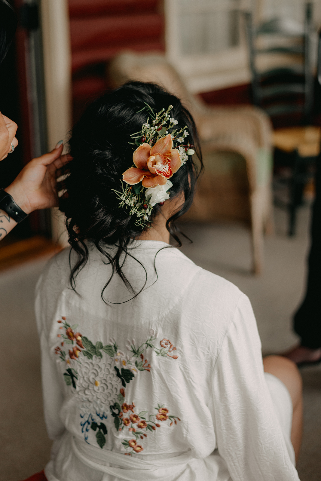 Bride with flowers in her hair and a wedding robe! - Pearl Weddings & Events