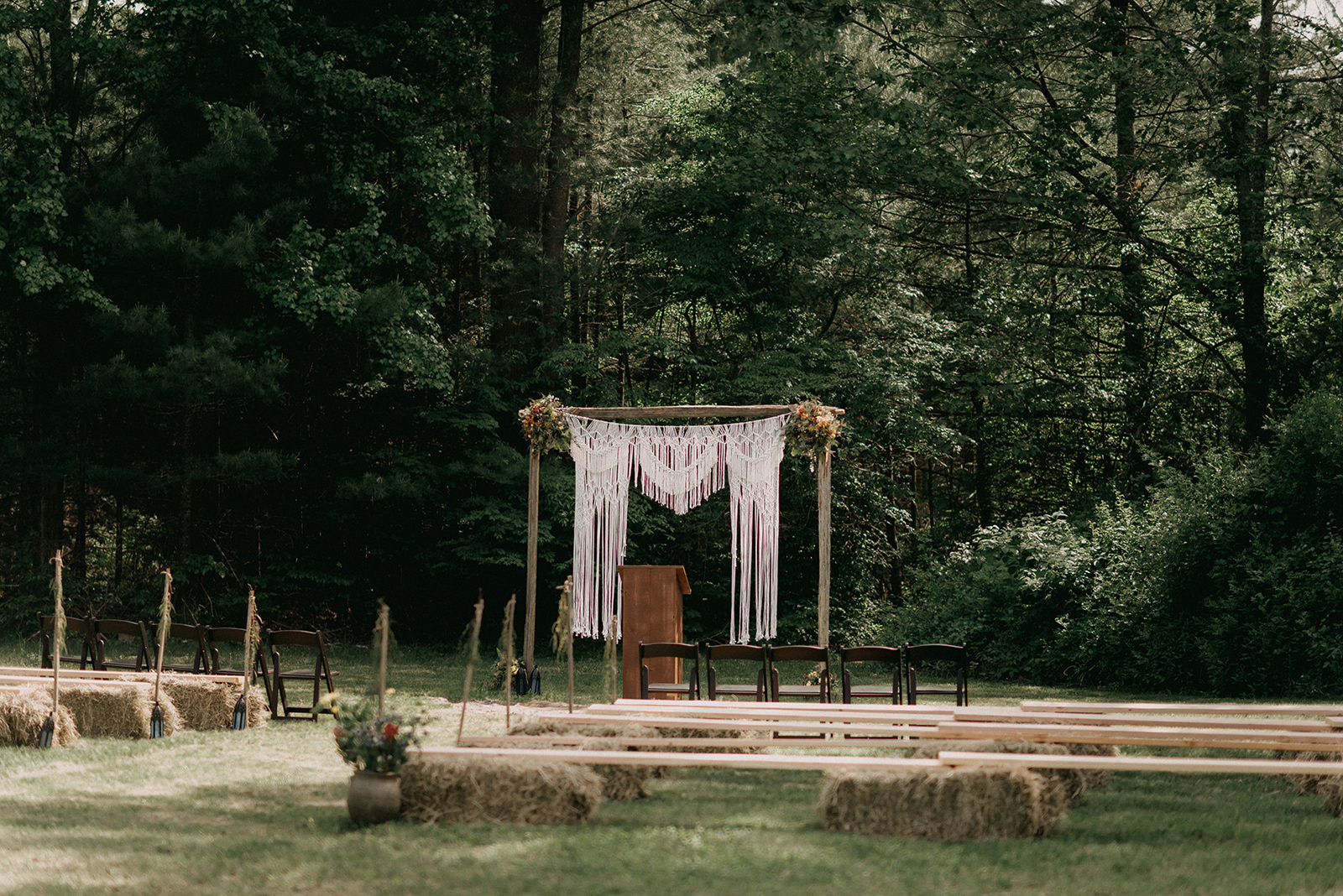 Macrame, boho ceremony with benches and hay bunches - Pearl Weddings & Events