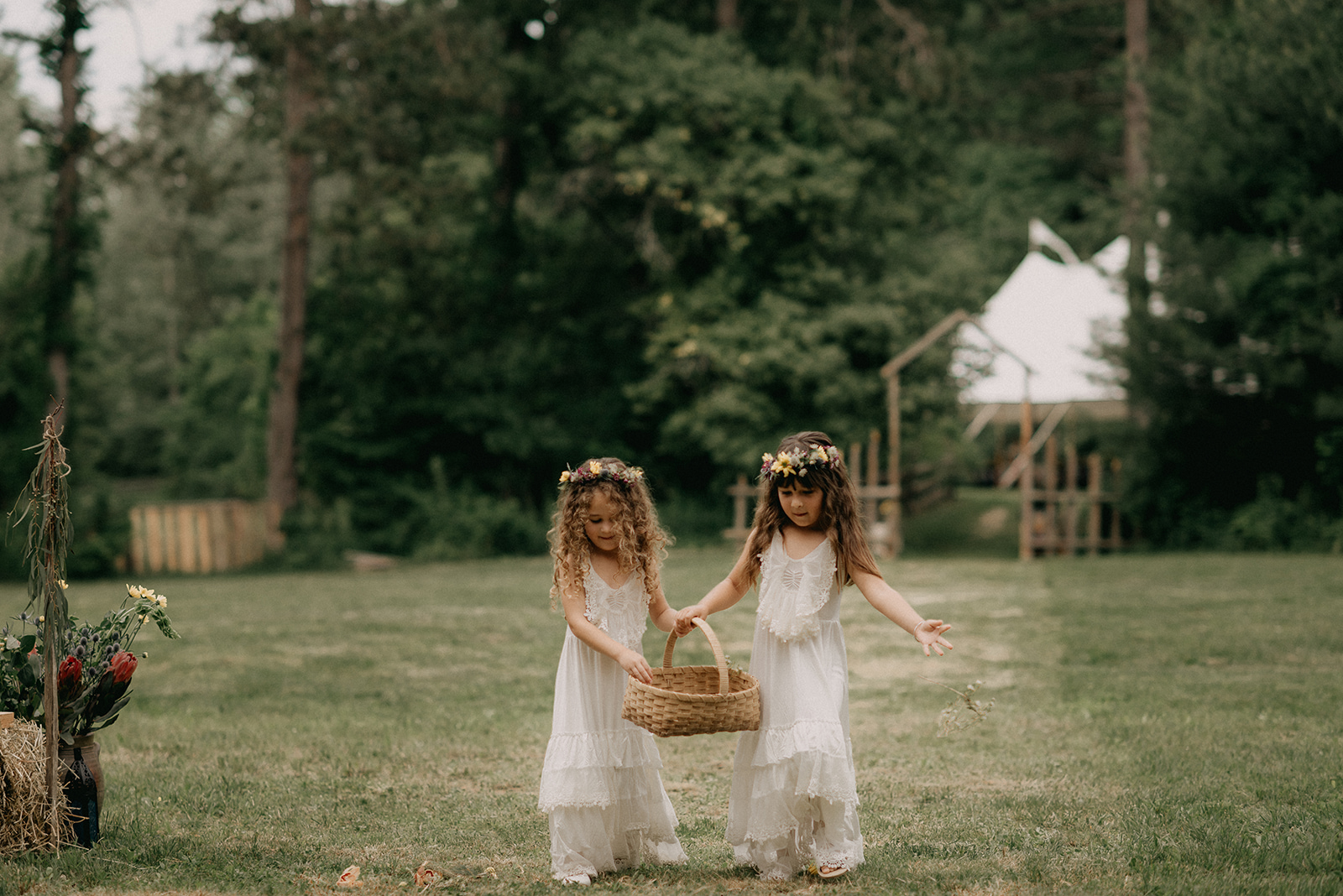 Flower girls with flower crowns down the aisle - Pearl Weddings & Events