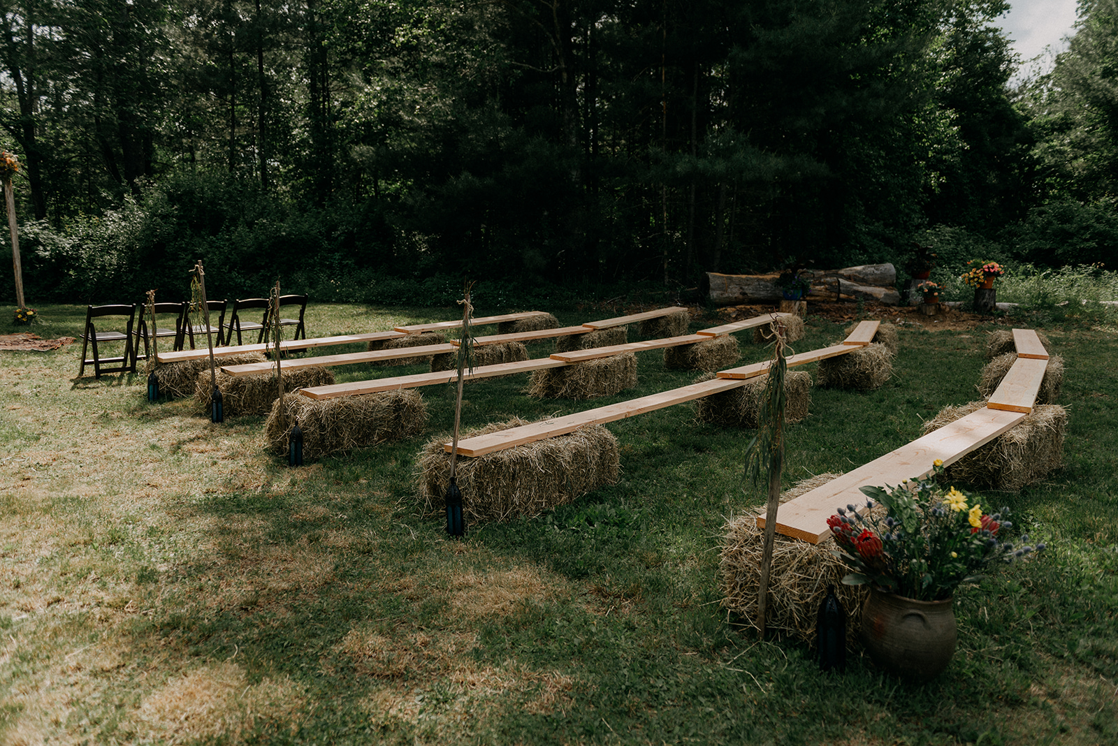 Outdoor ceremony seating for a antique farm, boho wedding - Pearl Weddings & Events