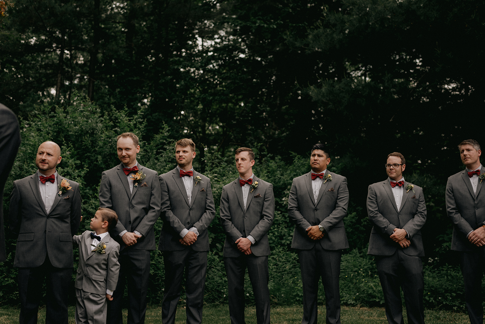 Groomsmen dress in grey suits with red bowties - Pearl Weddings & Events