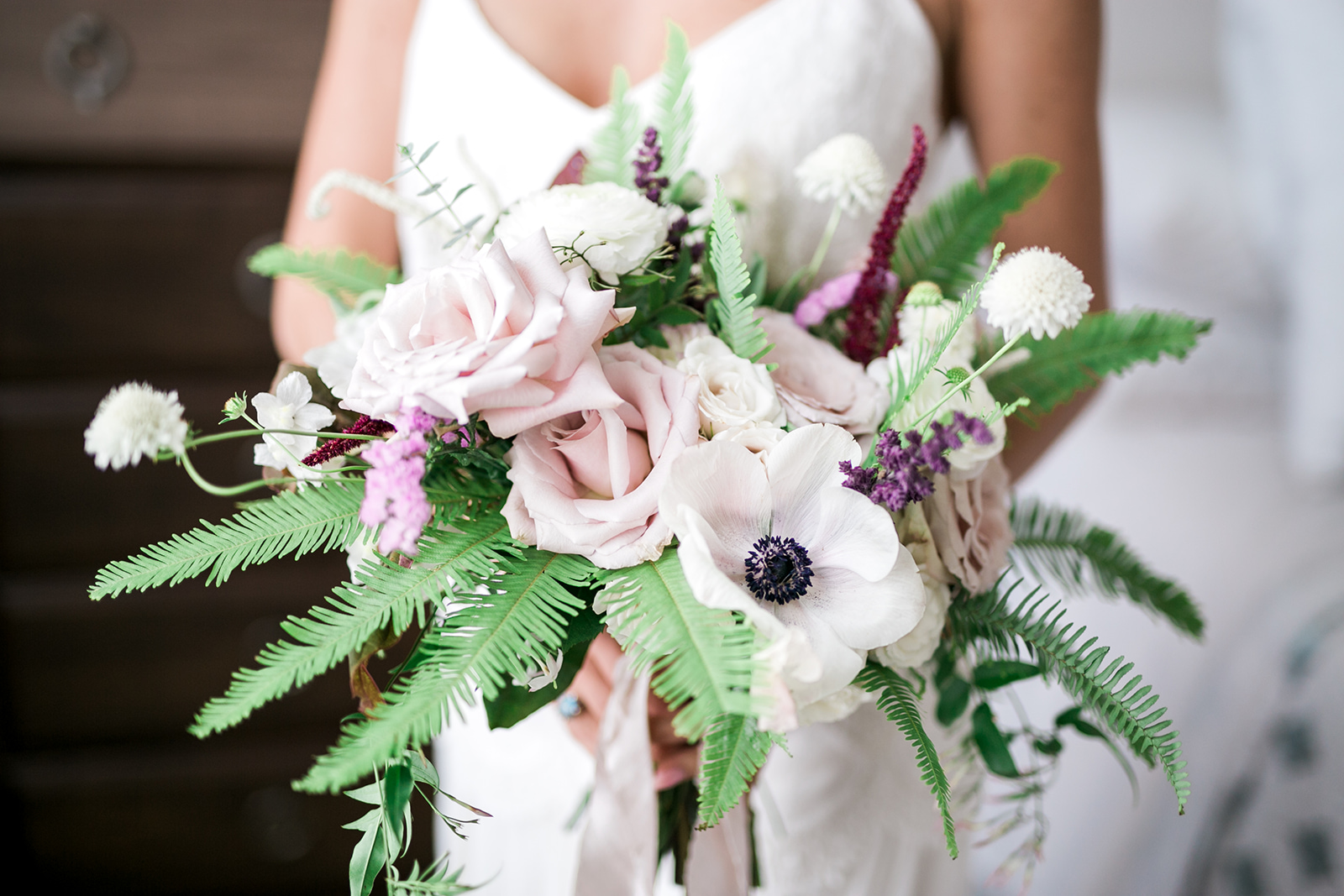 blush pink, lavender and deep red florals in the bridal bouquet - Pearl Weddings & Events
