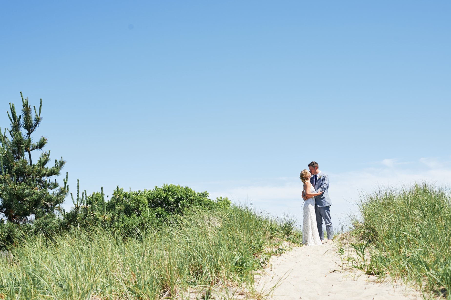 First look on the beach with the bride and groom in Rhode Island - Pearl Weddings & Events