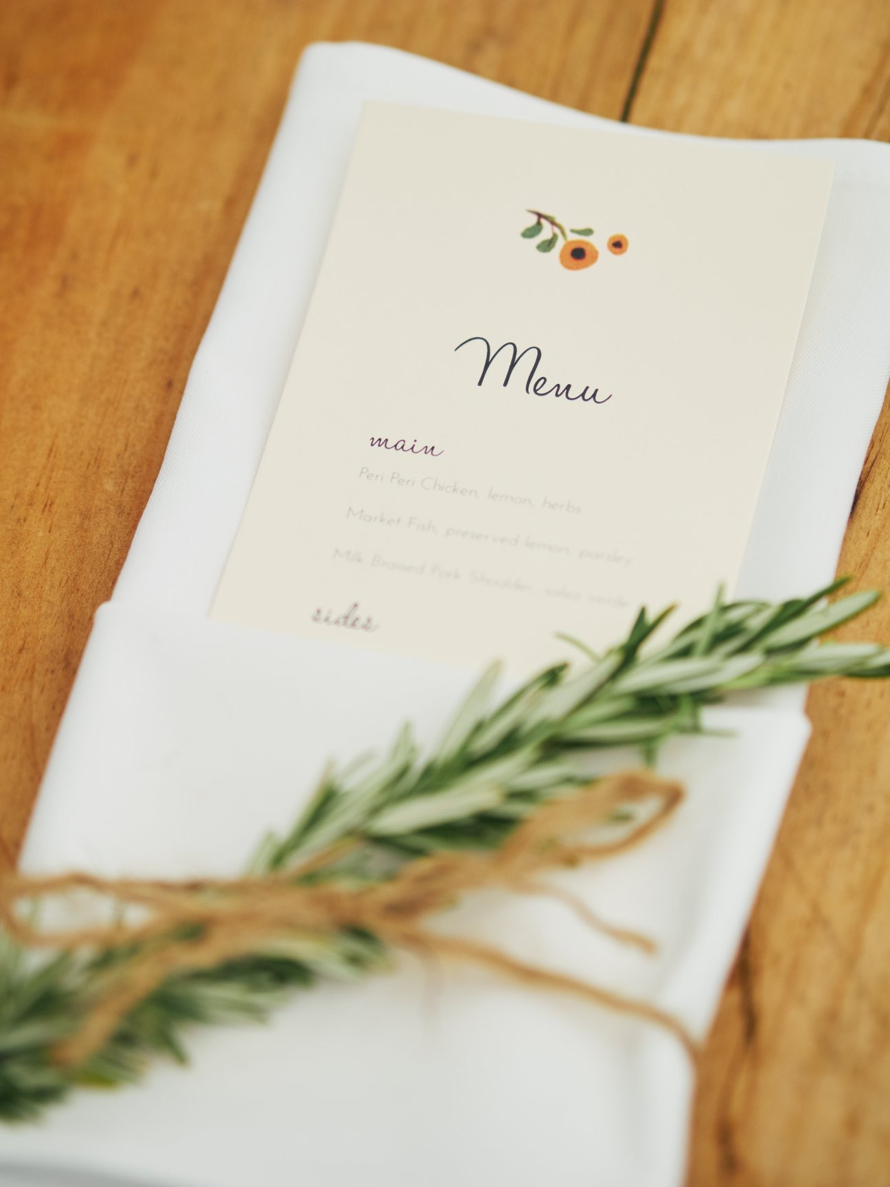 Wedding menu, napkins with a sprig of rosemary tied with hemp - Pearl Weddings & Events