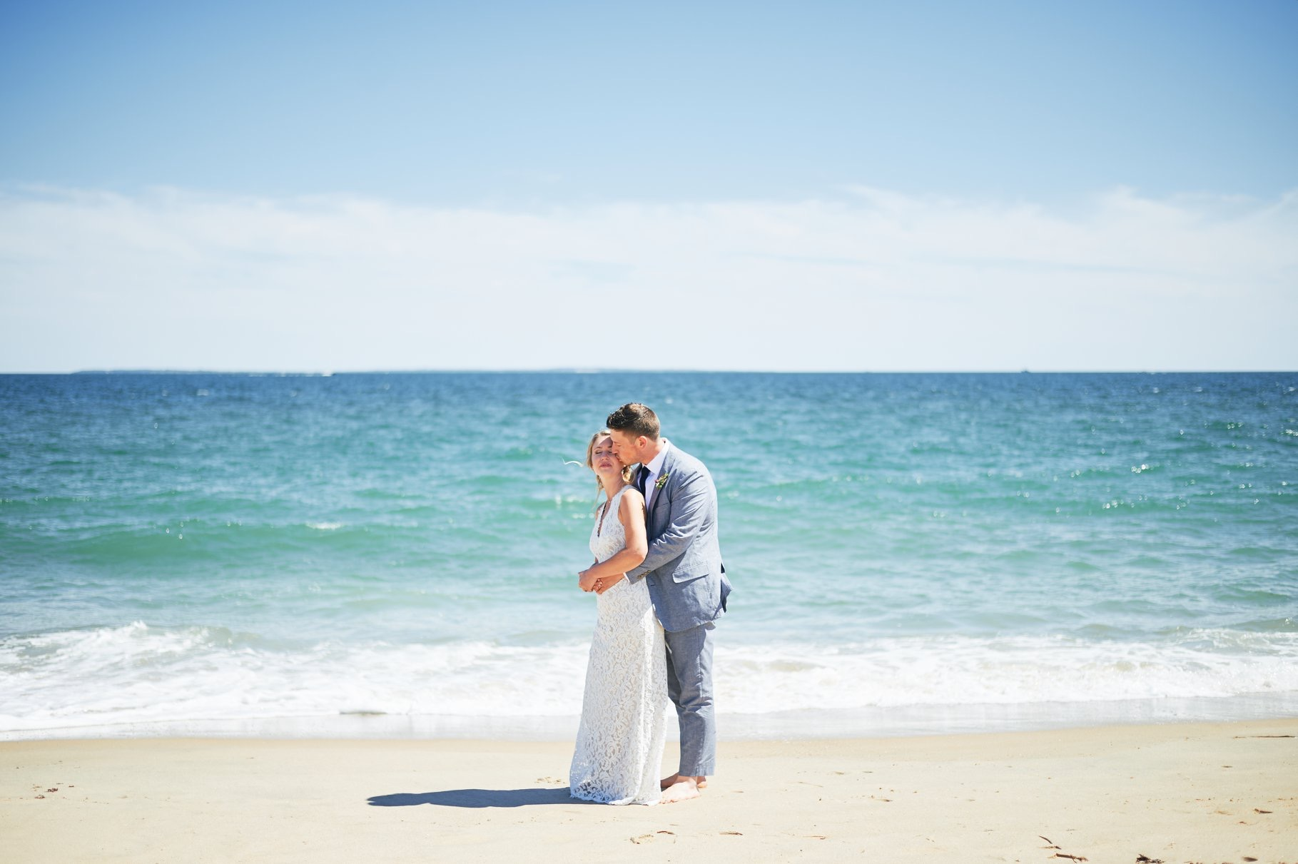 Bride and groom by the ocean on their wedding day - Pearl Weddings & Events