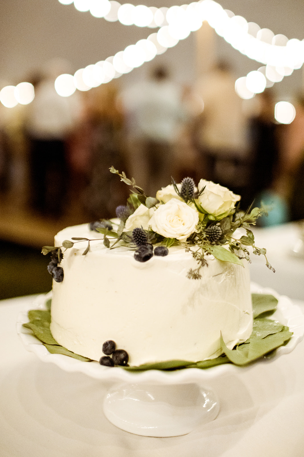 Simple white cake with greenery and blueberries - Pearl Weddings & Events