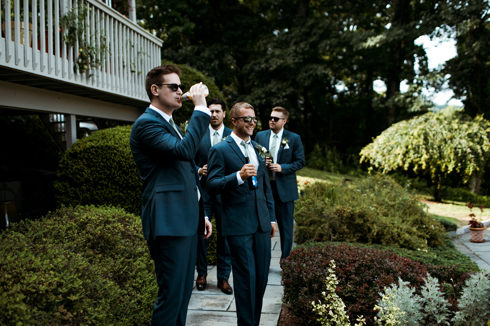 Groomsmen getting ready for the wedding! - Pearl Weddings & Events