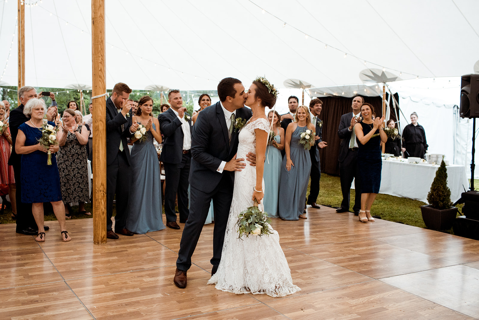 Bride and groom on the dance floor kissing after their bridal entrance! - Pearl Weddings & Events