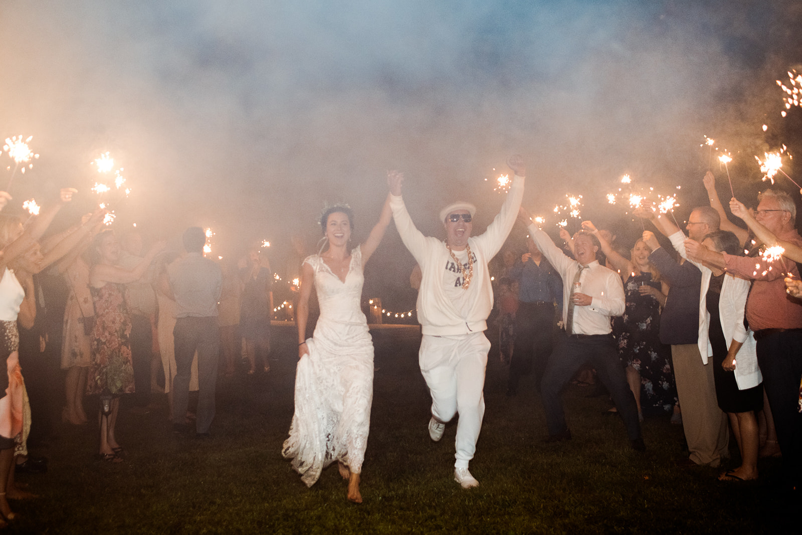 Sparkler exit with the groom! - Pearl Weddings & Events