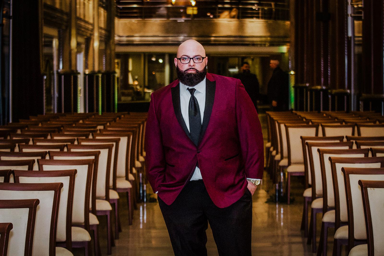 Groom in maroon and black JTGhamo suit at his Hartford Connecticut wedding - Pearl Weddings & Events