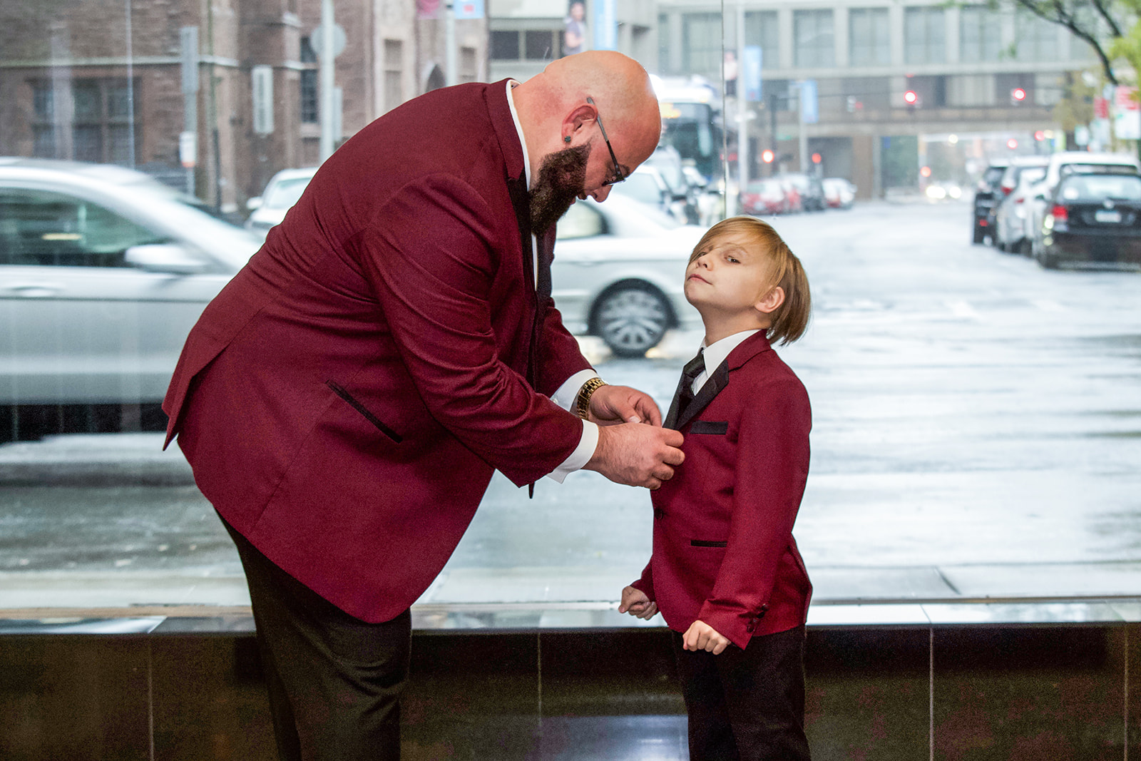 Groom's son as his ring bearer in a matching maroon and black suit - Pearl Weddings & Events