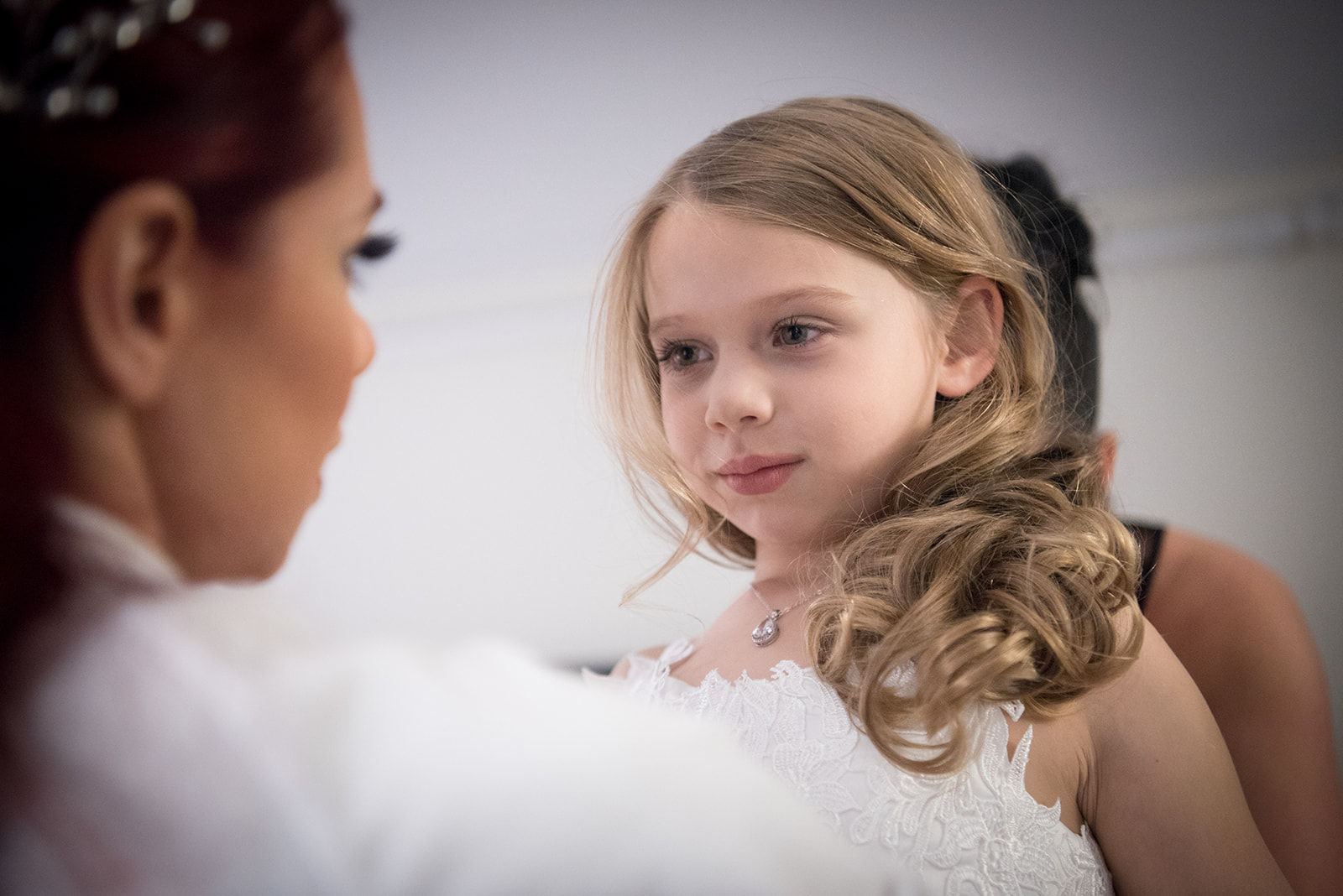 The bride's daughter is the flower girl and she is getting ready for her moment! - Pearl Weddings & Events