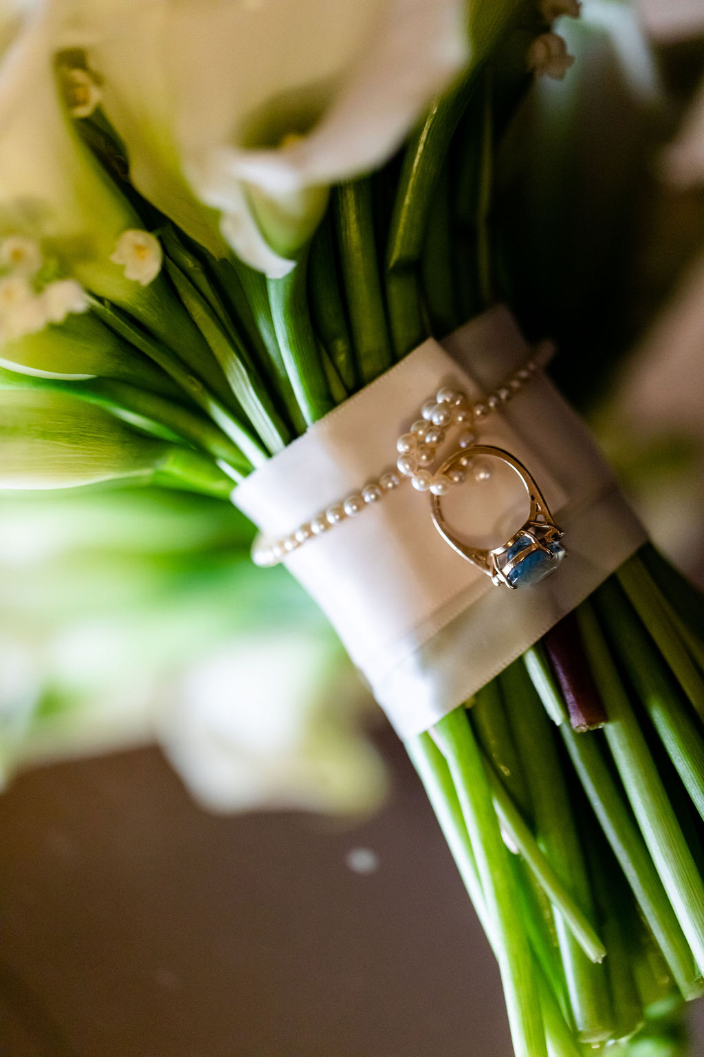 Something blue ring tied to the calla lily bridal bouquet  - Pearl Weddings & Events