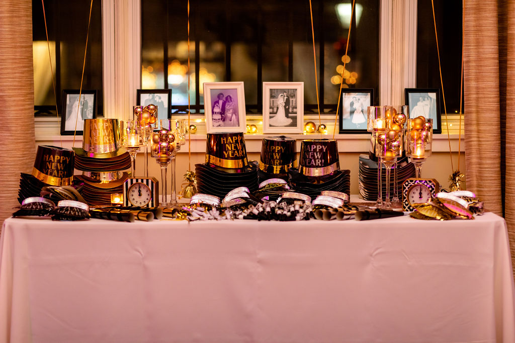New Years Eve party decor, noise makers and hate - Pearl Weddings & Events