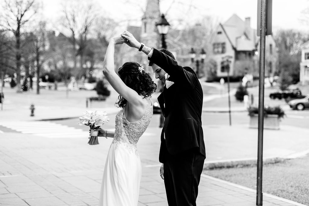 Groom spinning his bride after their first look - Pearl Weddings & Events