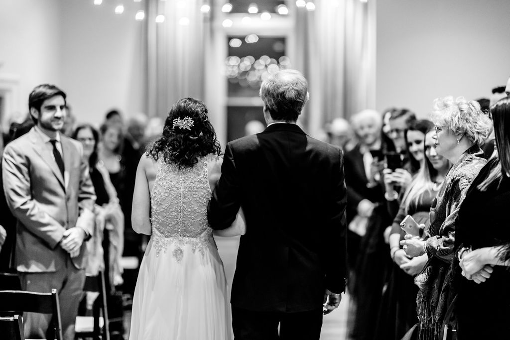 Bride walking down the aisle with her father - Pearl Weddings & Events