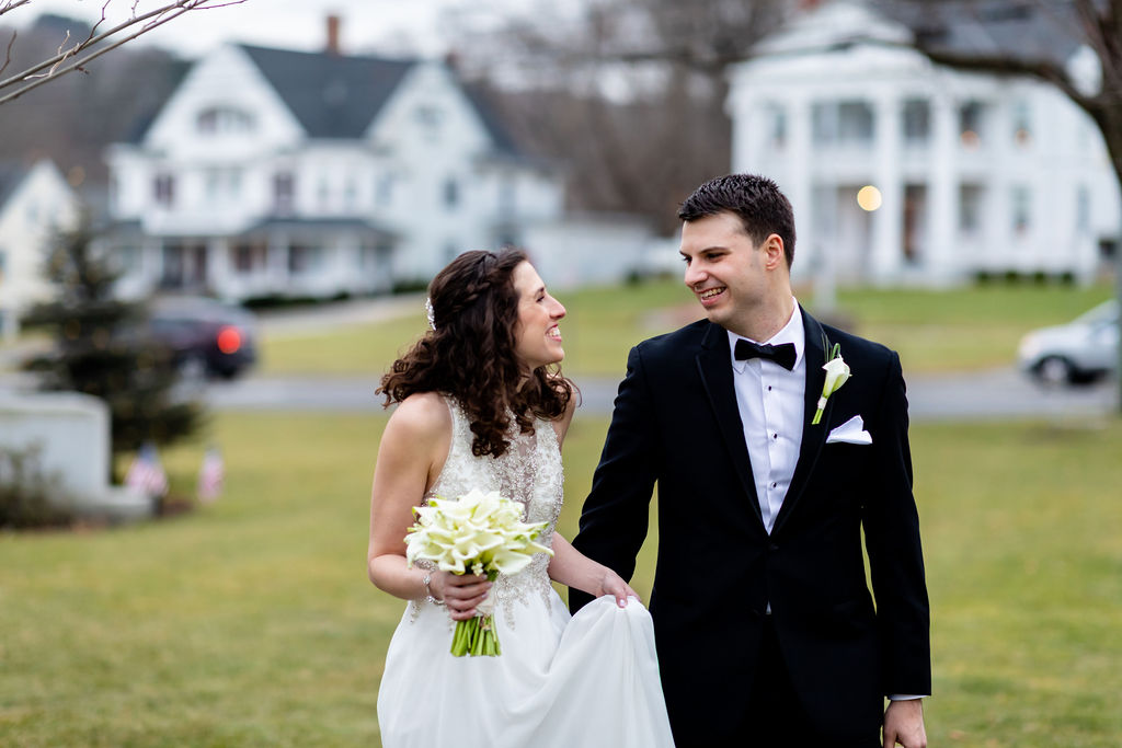 Bride and groom walking together after their first look - Pearl Weddings & Events