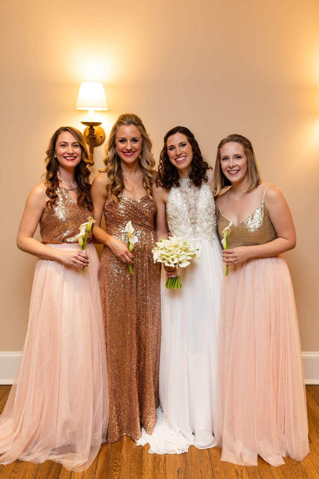 Bridesmaids in rose gold sparkly tops and blush pink bottoms - Pearl Weddings & Events