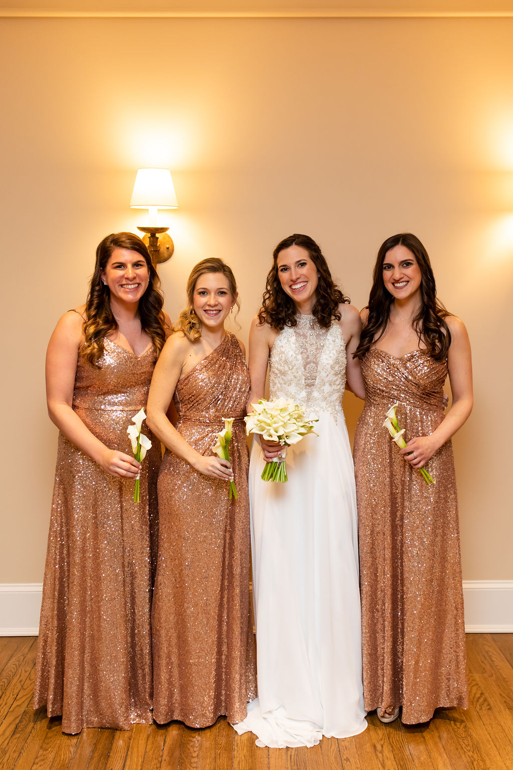 Bridesmaids in rose gold sparkly dresses with Calla Lily bouquets - Pearl Weddings & Events