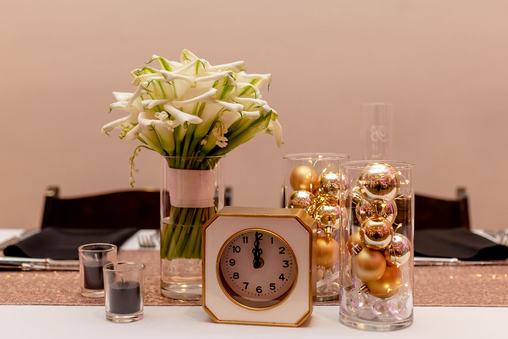 calla lilies, gold ornaments, twinkly lights, clocks on midnight and black candles - Pearl Weddings & Events