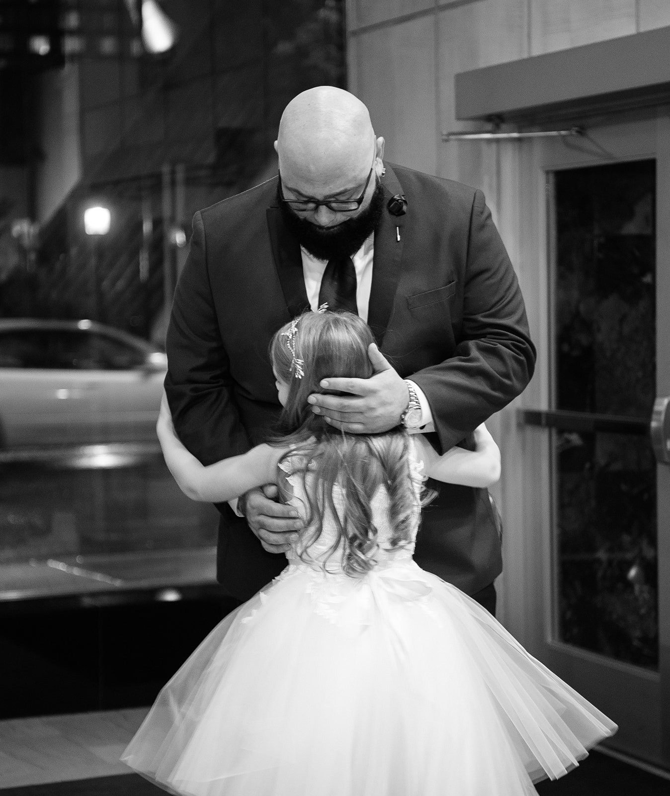 flower girl hugging her dad at the altar! - Pearl Weddings & Events