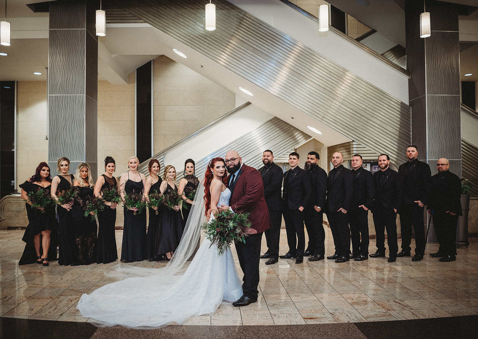bridal party dressed in all black in an art deco venue in connecticut - Pearl Weddings & Events