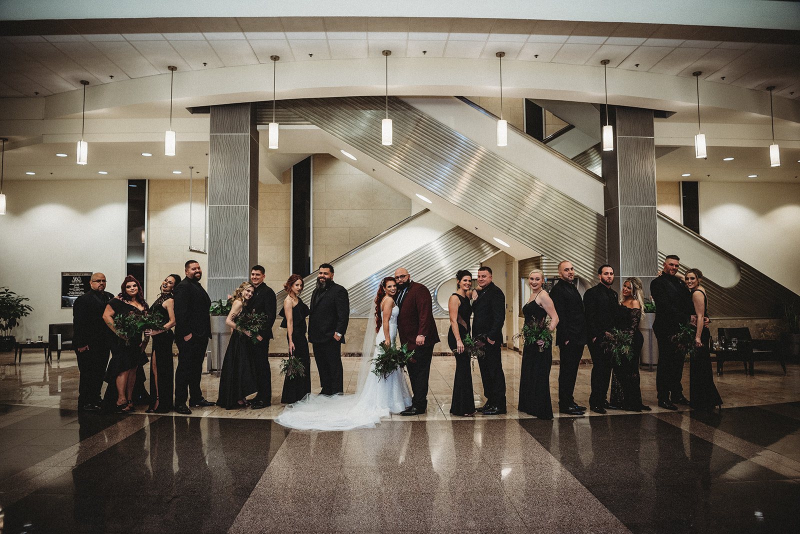 bridal party dressed in all black in a unique art deco venue in connecticut - Pearl Weddings & Events