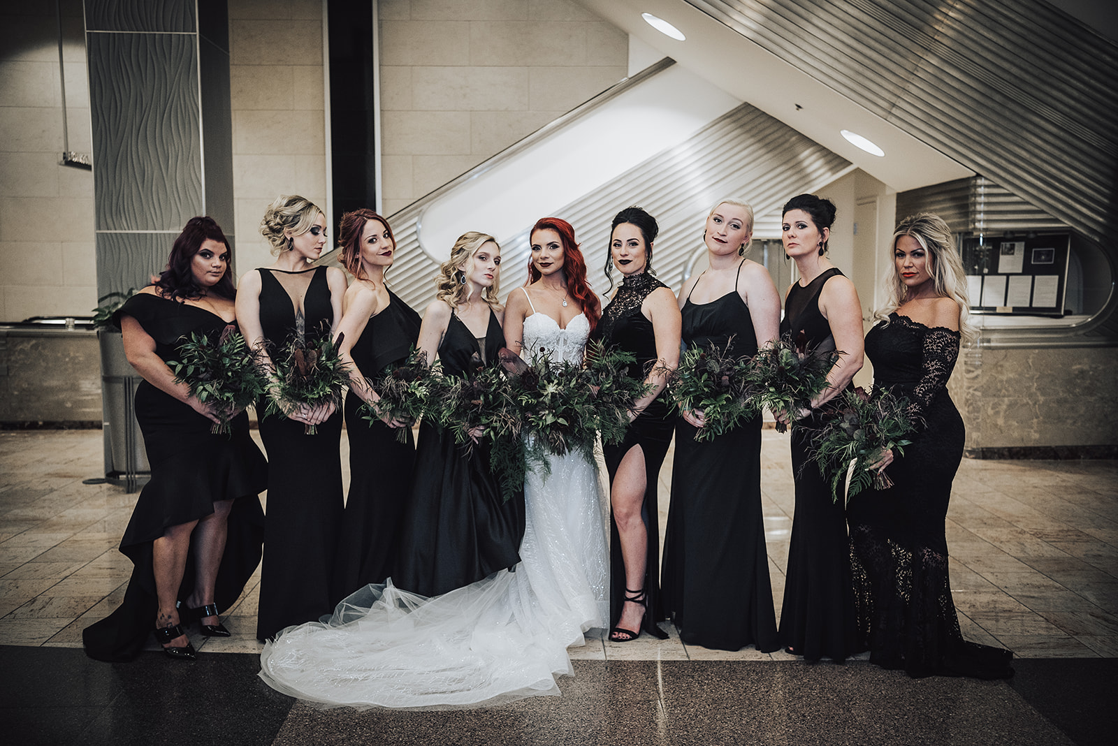 bridesmaids in all black with deep greens and maroon leafy bridal bouquets - Pearl Weddings & Events