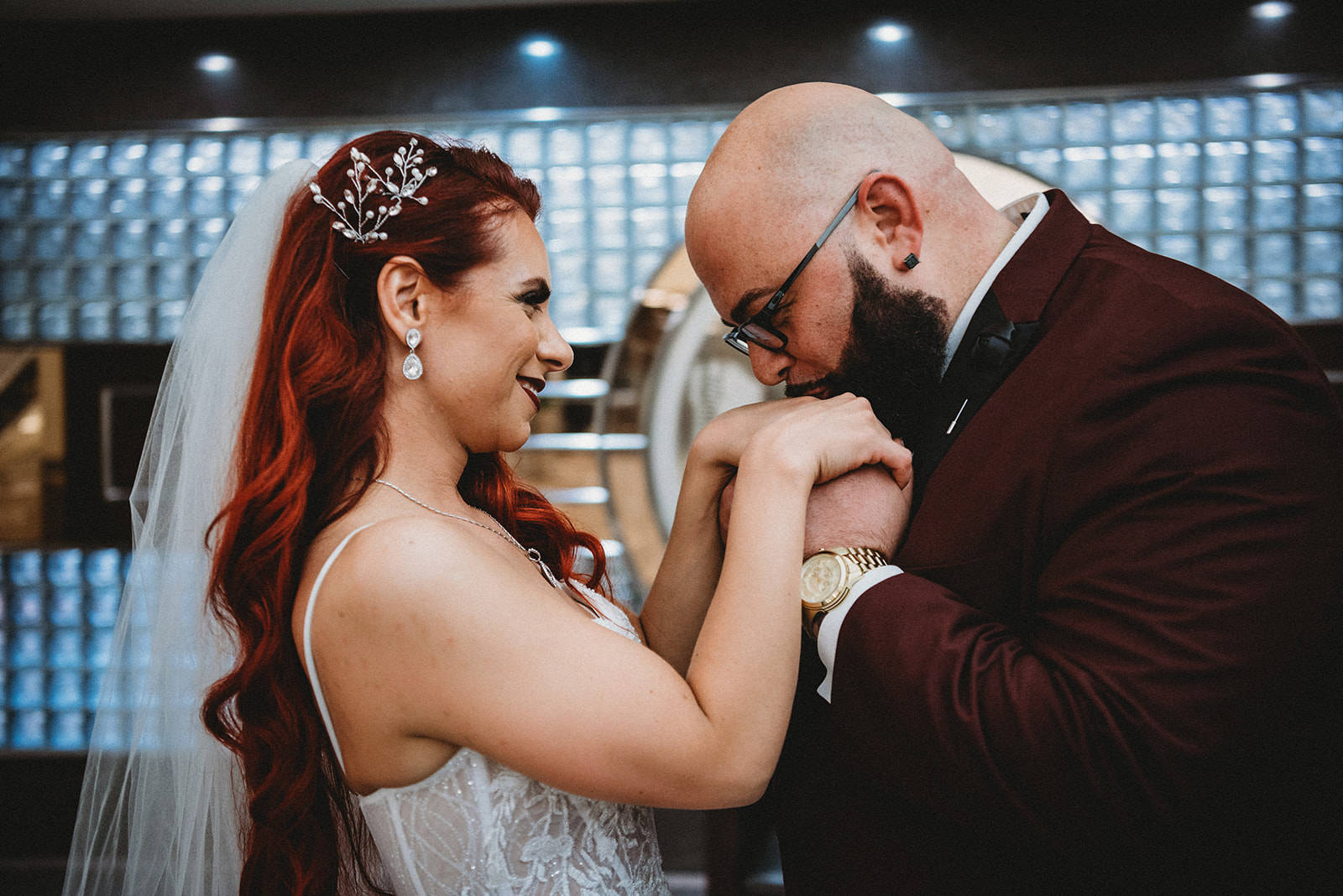 Groom kissing the hands of his bride - Pearl Weddings & Events