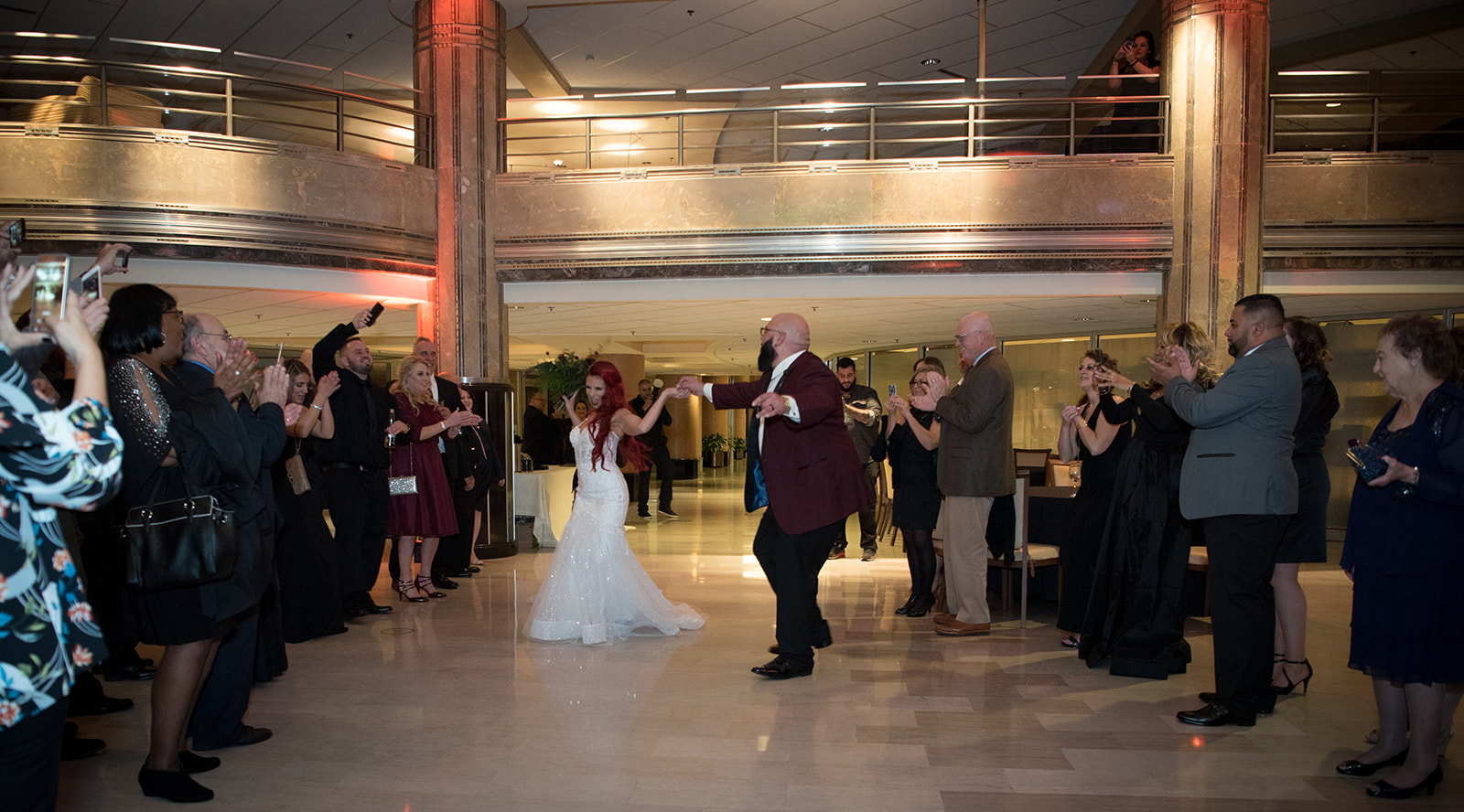 bride and groom dancing to their entrance down and aisle of their guests before the reception - Pearl Weddings & Events