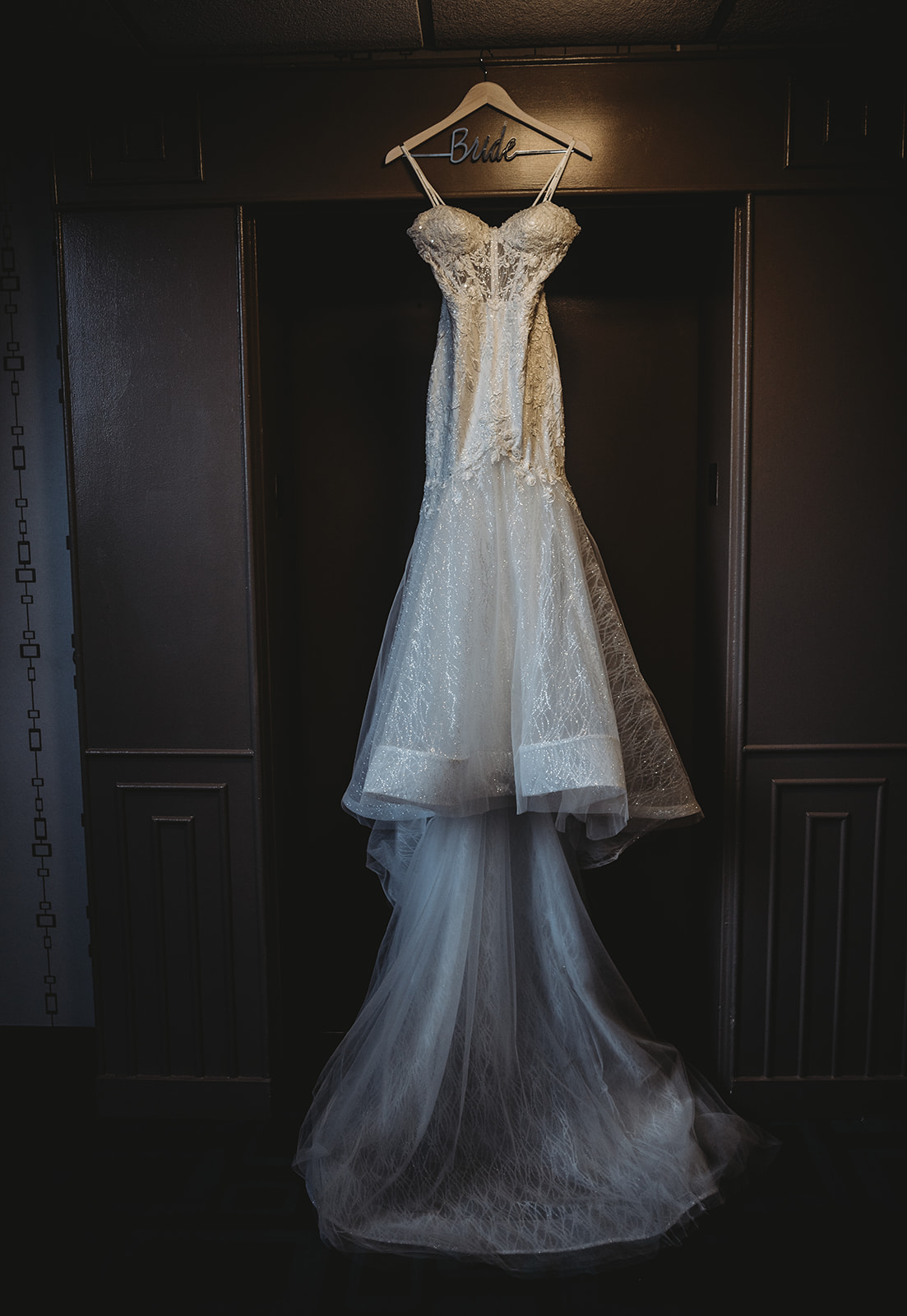 brides calla blanche wedding dress hung for photos in hartford connecticut - Pearl Weddings & Events