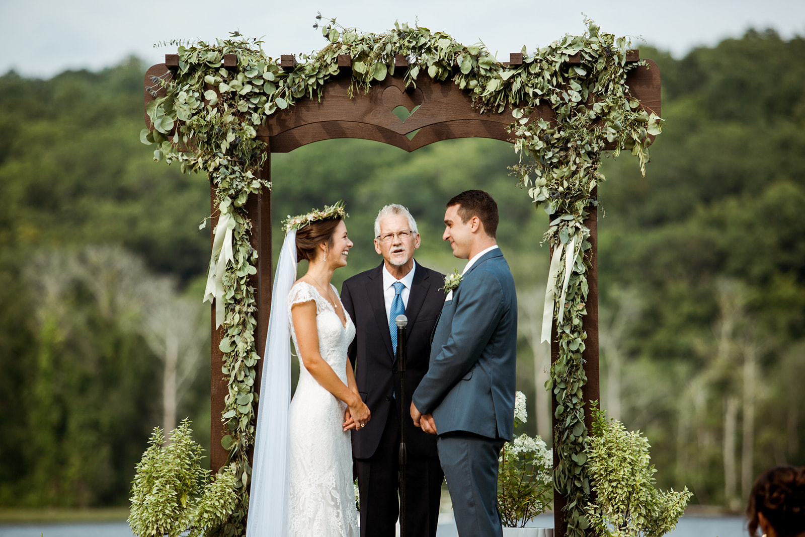 Their ceremony archway was built by Sommar's uncle. The details of his woodwork went beautifully with the backdrop and perfect potted plants! - Pearl Weddings & Events