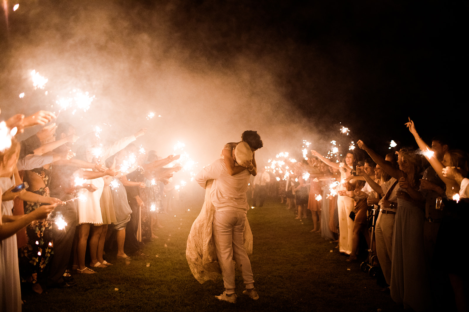 Sparkler exit at an outdoor tented wedding in Chester, Connecticut - Pearl Weddings & Events