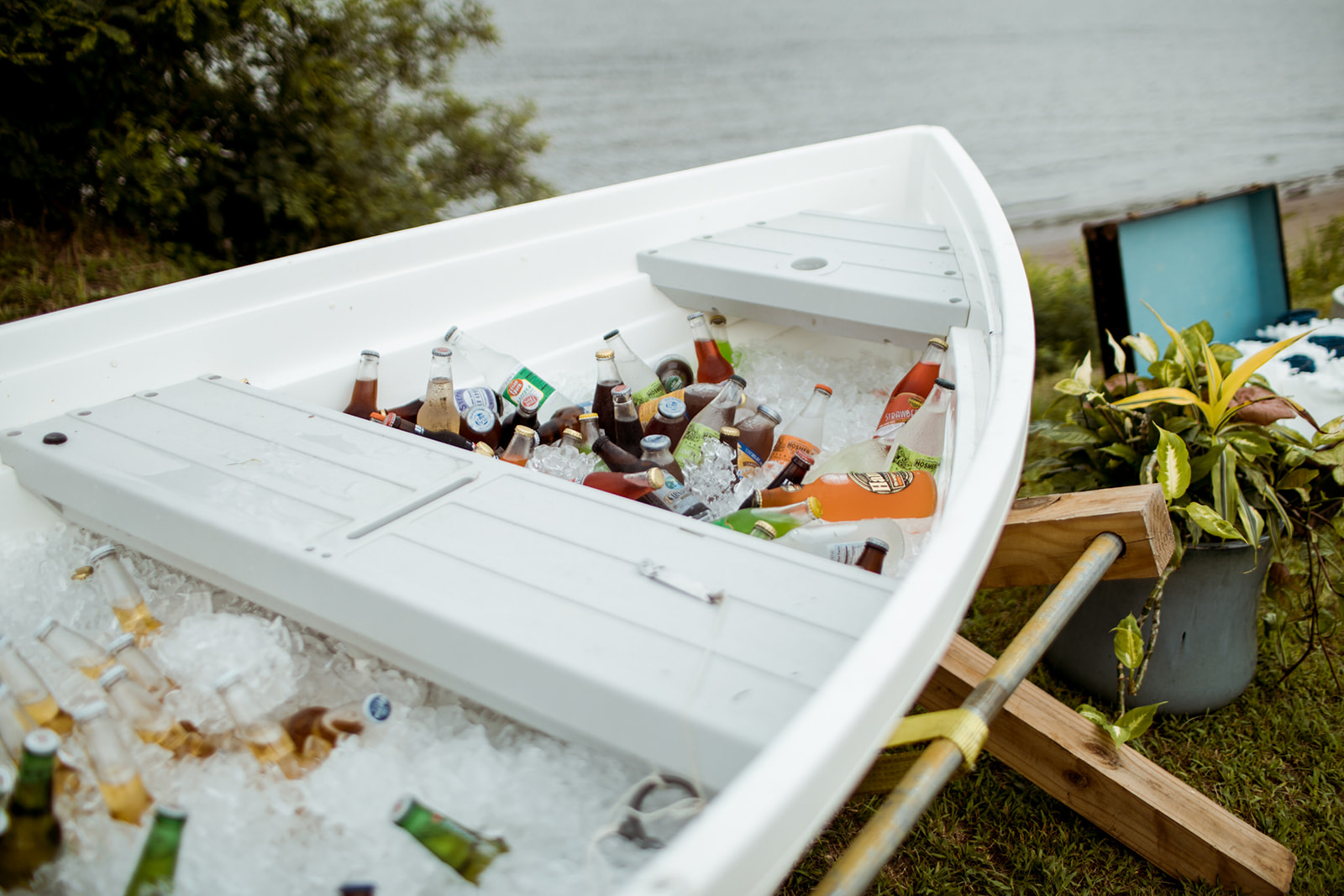 An actual boat filled with ice and drinks for wedding guests to serve them self! - Pearl Weddings & Events