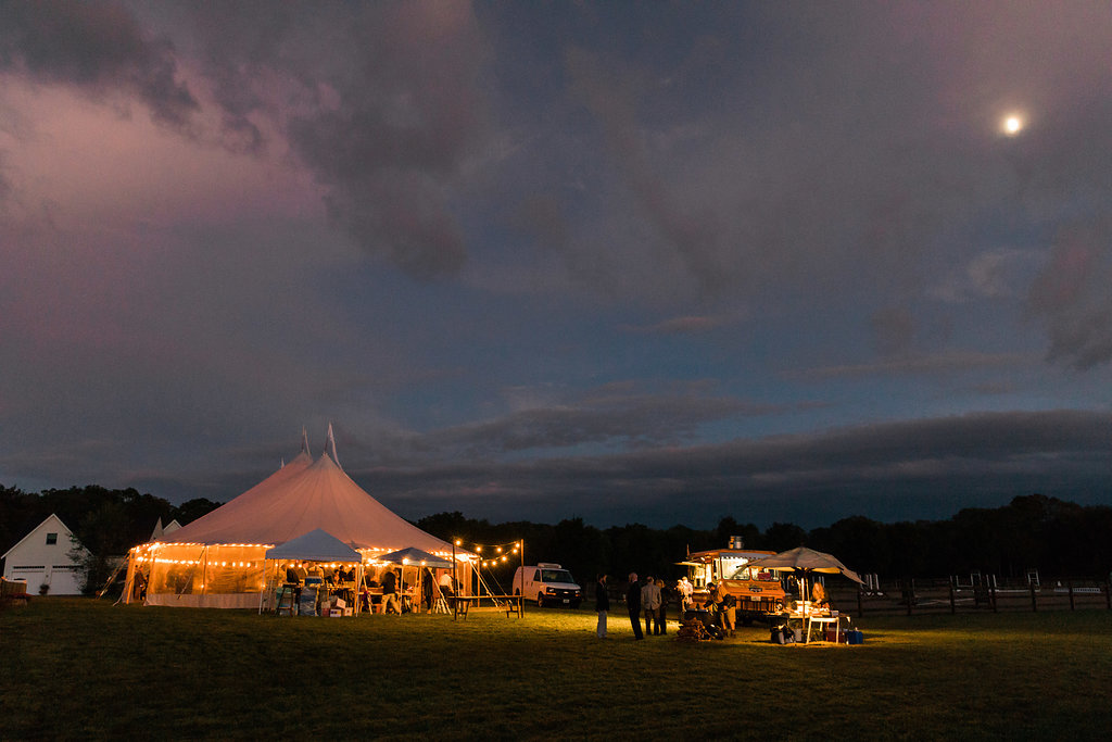 night time tent light up with cafe lighting - Pearl Weddings & Events
