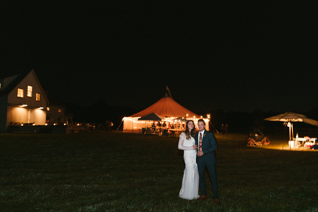 late night photo of the bride and groom with their tent in the background! - Pearl Weddings & Events