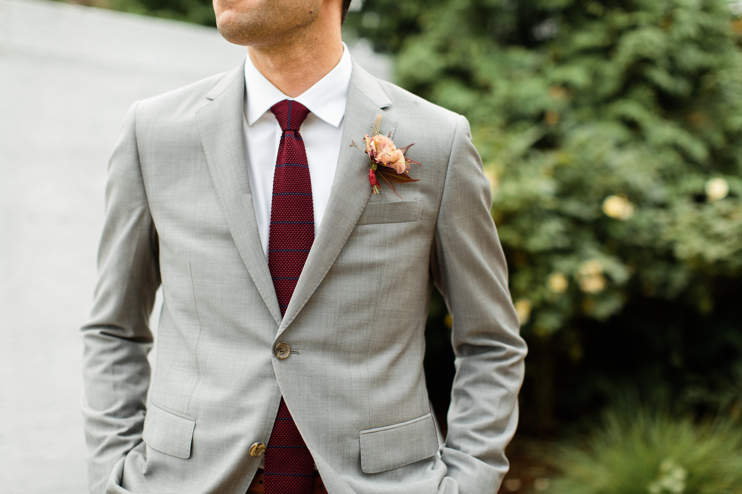 Grey suit with a maroon tie for the groom at Stony Creek Brewery - Pearl Weddings & Events