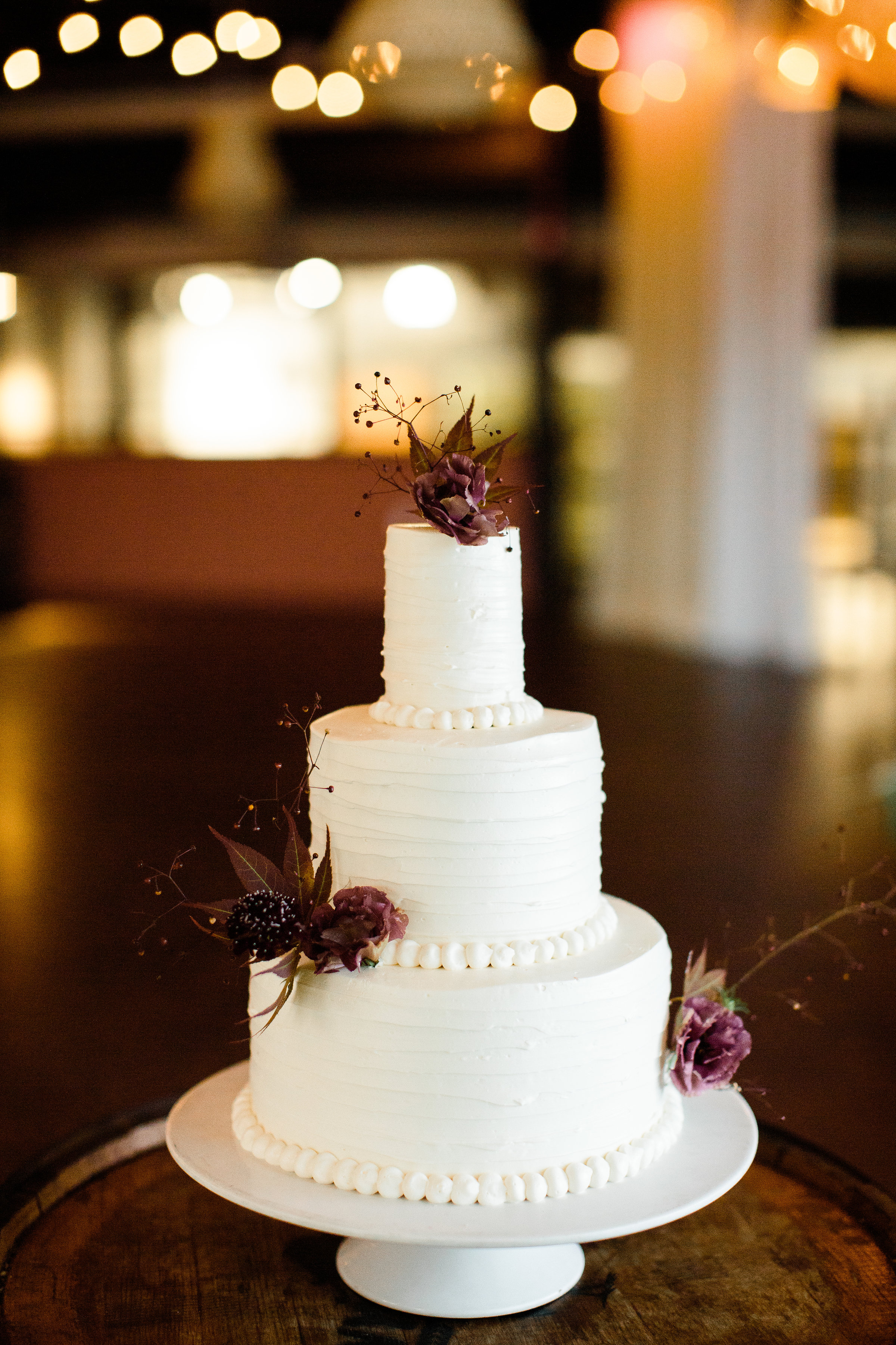 Three tiered (top tier small) white cake from LaCuisine - Pearl Weddings & Events
