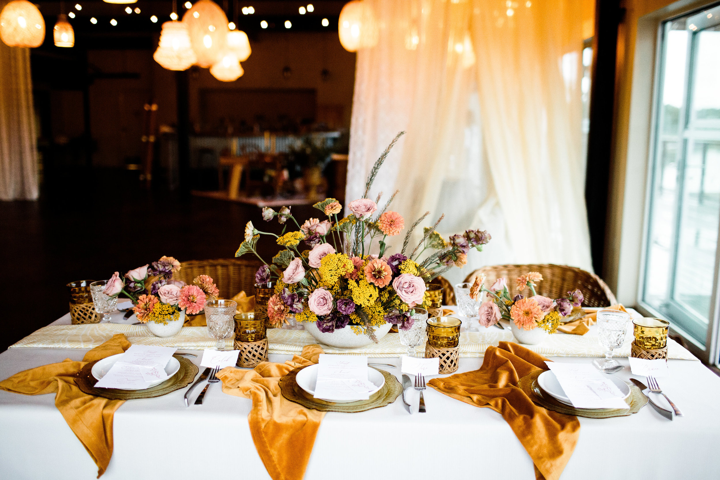 Boho and modern style with fall colors and turmeric velvet napkins and yellow pops - Pearl Weddings & Events