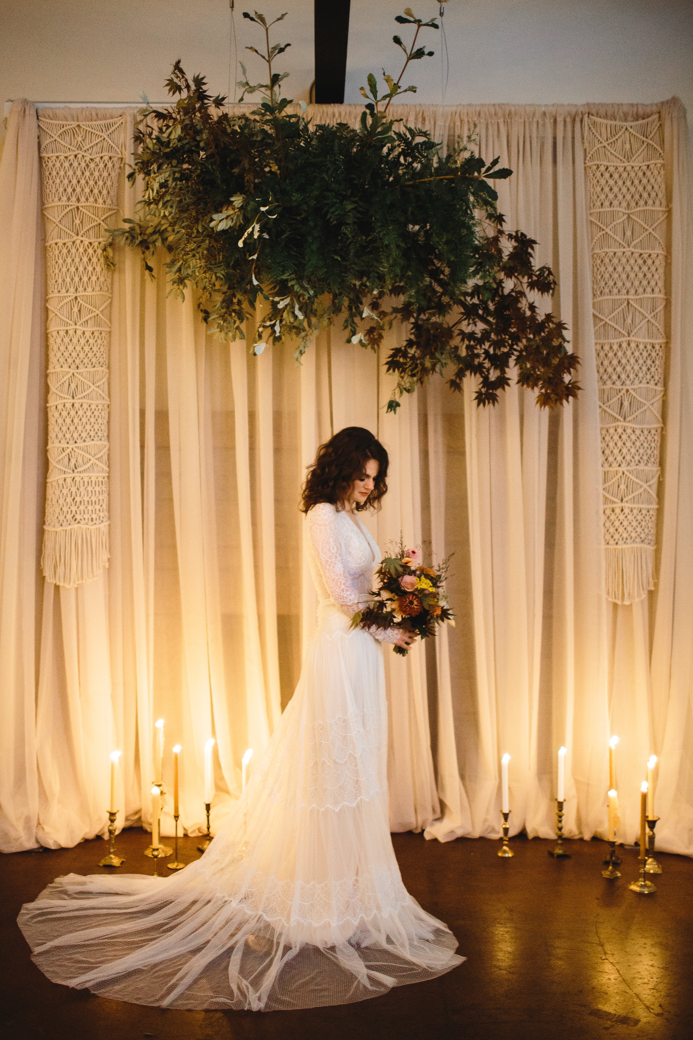 Greenery lush floral install over your ceremony space with a taper  candle  set up and back drop - Pearl Weddings & Events