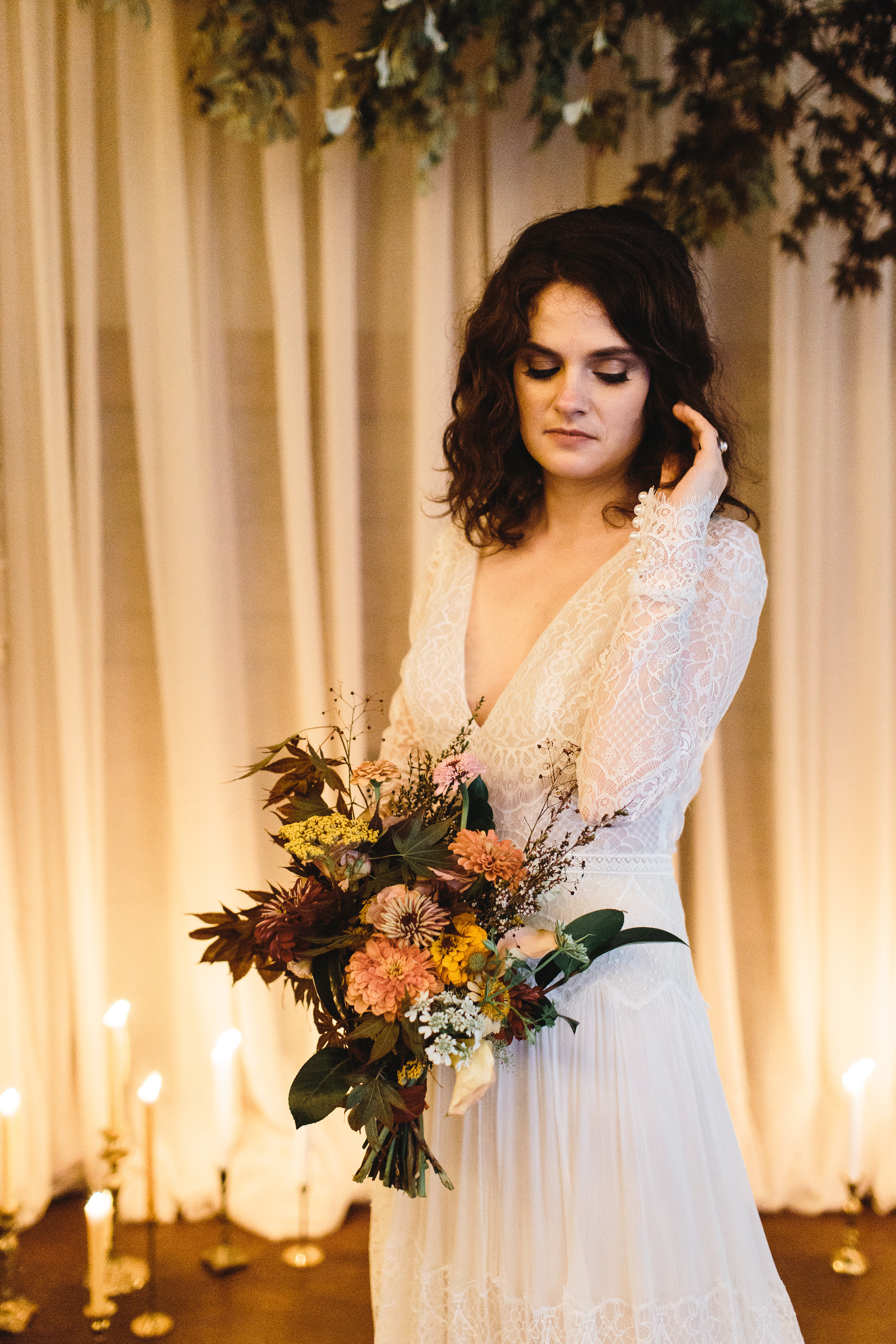 Bride in Alexandra Grecco gown, hair down and gorgeous florals - Pearl Weddings & Events