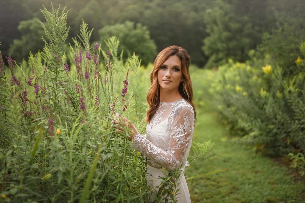 Bride in a two piece wedding dress in a lavender field in New Fairfield Connecticut - Pearl Weddings & Events